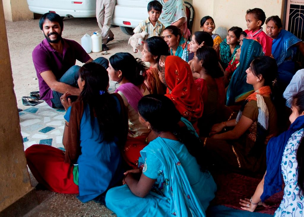 Aditya facilitating a workshop on building trust and safe spaces within the community with a group of working women in Okhla, Delhi