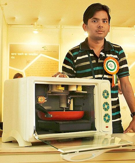 Abhishek with his innovation Robocook.
