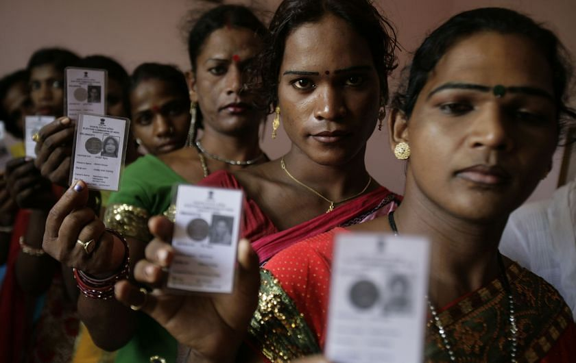Image of transgender persons holding election cards