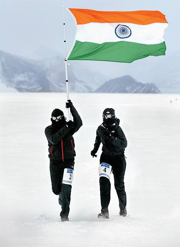 Uma and Krishna with the Indian flag in Antartica