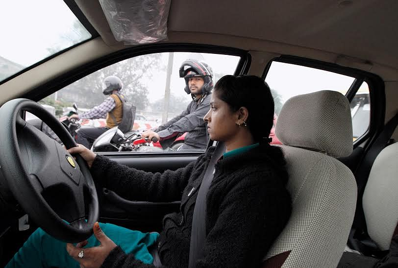 This picture of Savita, a young taxi driver in New Delhi, is one of the most memorable shots that photographer Nicolaus Schmidt took for his book. (Credit: Nicolaus Schmidt)