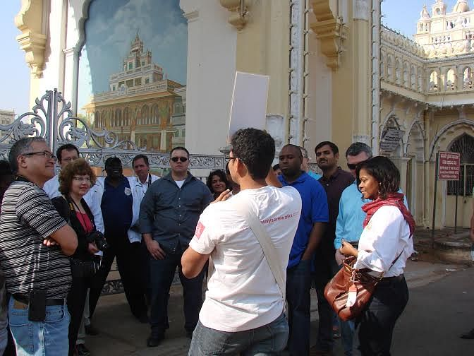 Vinay Nagaraju with a group of travel enthusiasts in front of the Amba Vilas Palace in the city.