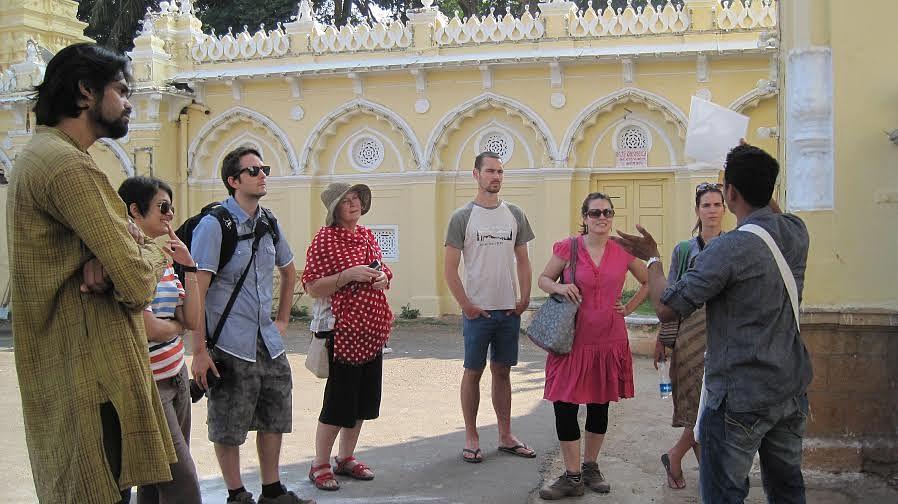 Vinay with tourists at Amba Vilas Palace.