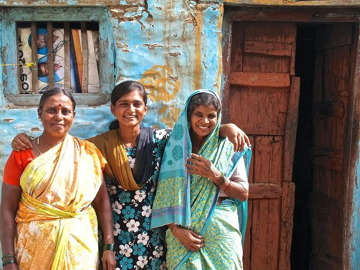 Roja with her aunt and mother in front of her house.