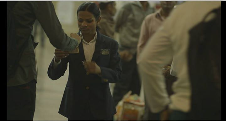 Dutee checking tickets at a Mumbai railway station. (Image Credits Dutee Facebook page and Real Sports)