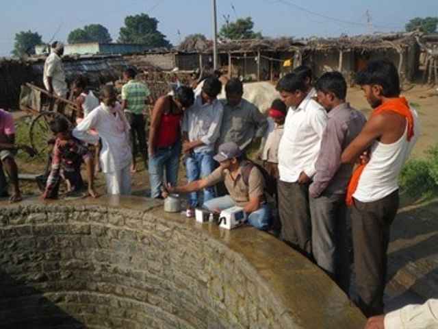 Manyali residents testing water from their well