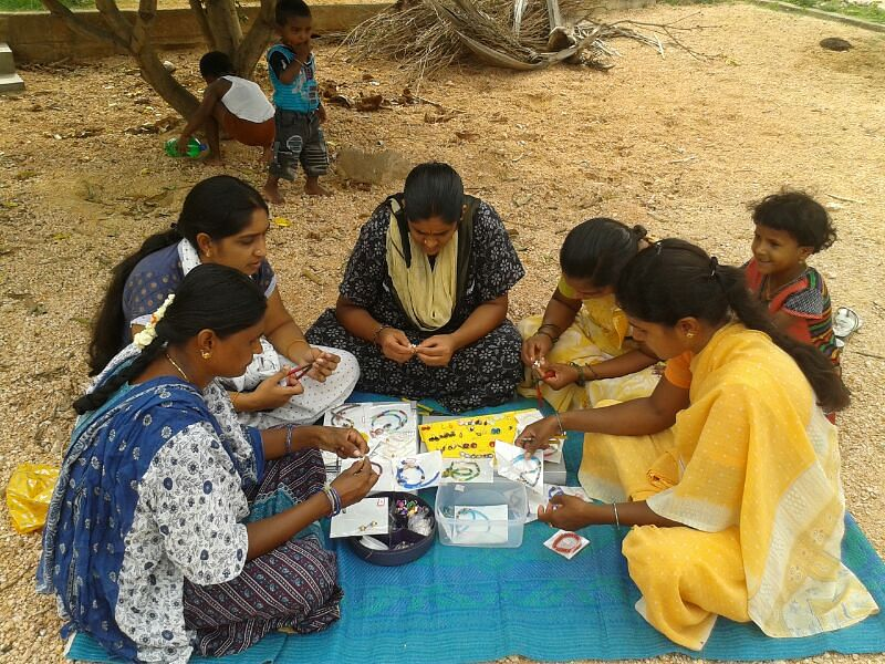 Women are given jewellery making training after field work.