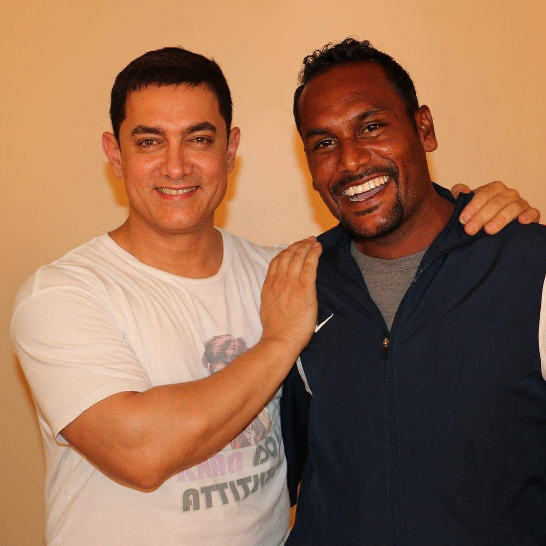 Akhilesh (right) with Amir Khan.