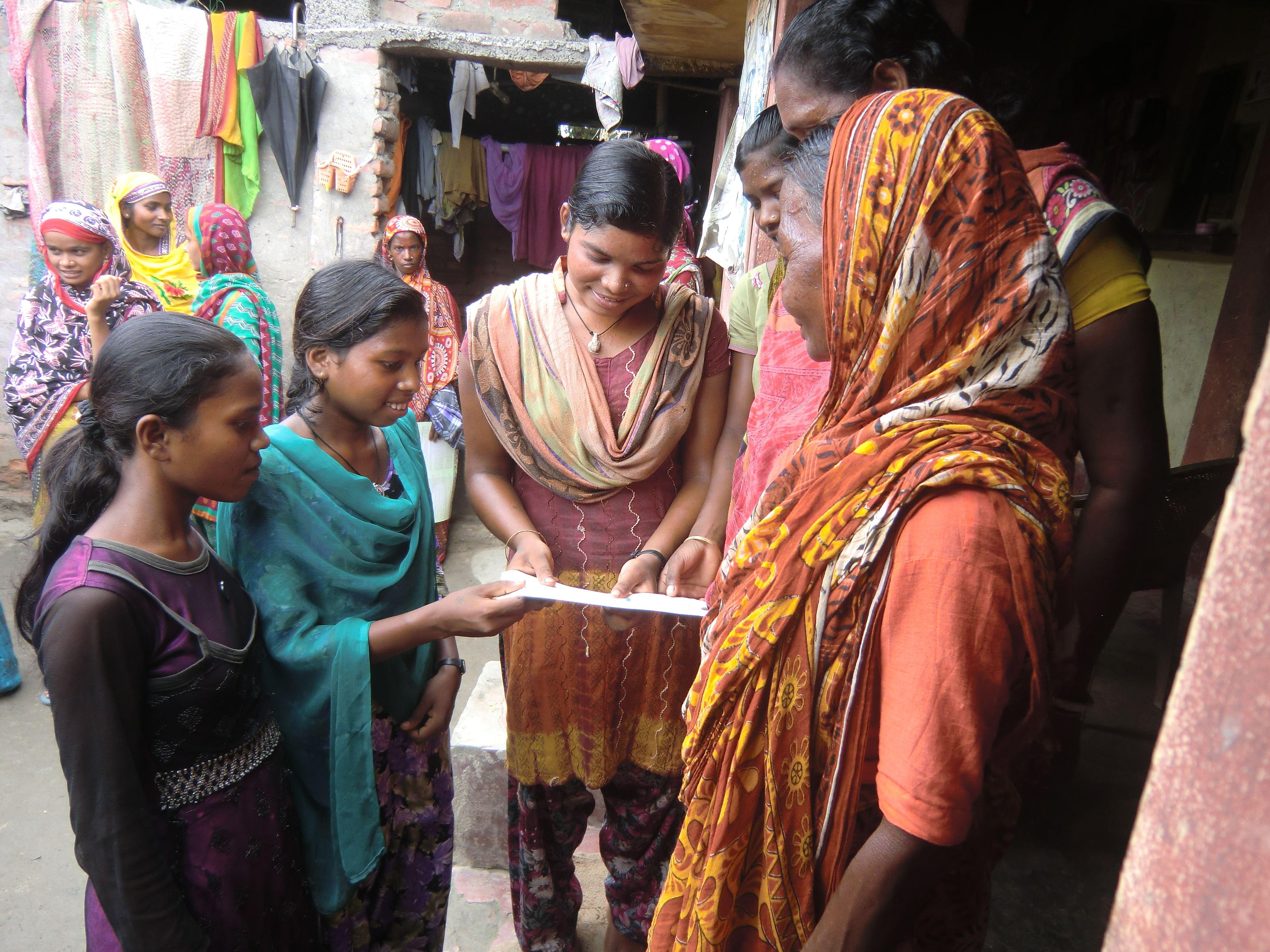 Girls of the Kishori group in Nooniya Basti, which falls under Mahingaon gram panchayat in Bihar's Kishanganj district, make door-to-door visits talking to women about family planning, safe motherhood and the importance of eating nutritious meals. (Credit: Ajitha Menon\WFS)