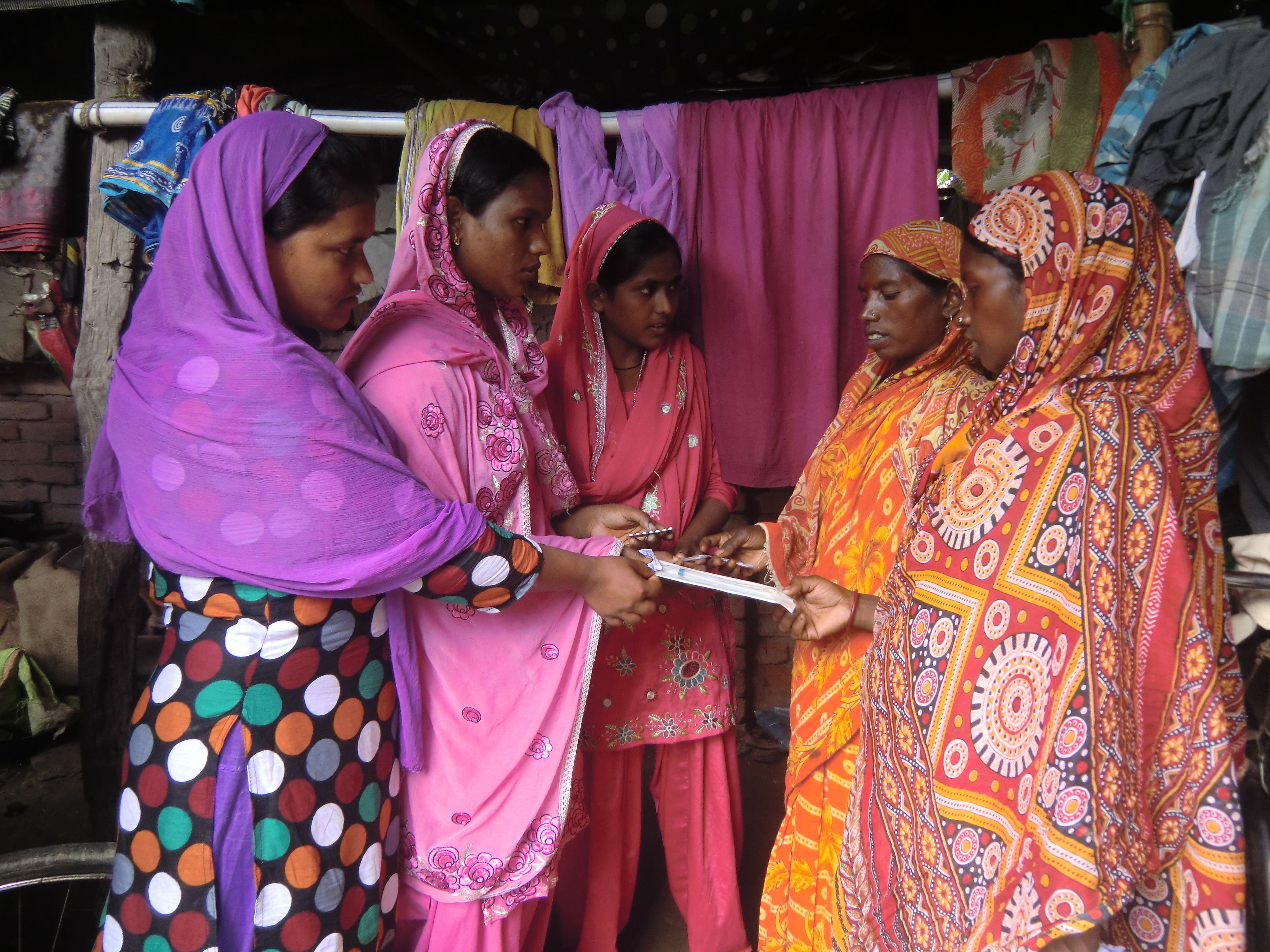 Without inhibition, the Kishori group members of Nooniya Basti interact with older women showing them samples of contraceptive pills, Copper T and condoms and telling them about the merits of keeping at a five-year gap between children. (Credit: Ajitha Menon\WFS)