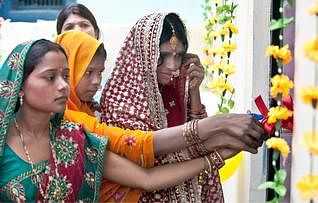 Priyanka Bharti (extreme left) with two other brides on the opening ceremony of the toilet.