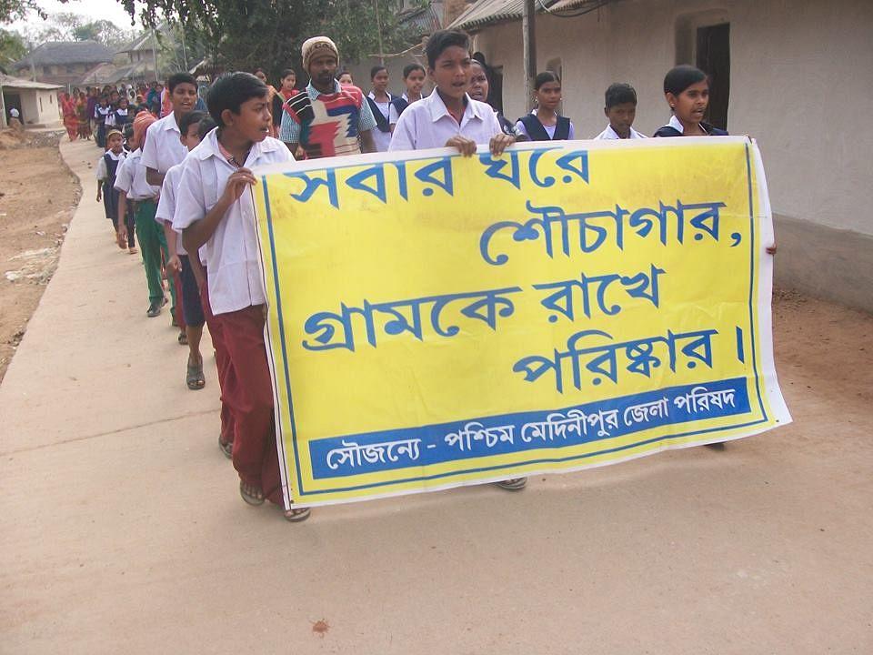 Rally by School students help by Gram Panchayat in Khudmarai (West Bengal)