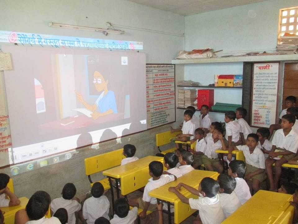Students keenly watching awareness video - SBM Kolhapur Zilla (Maharastra)