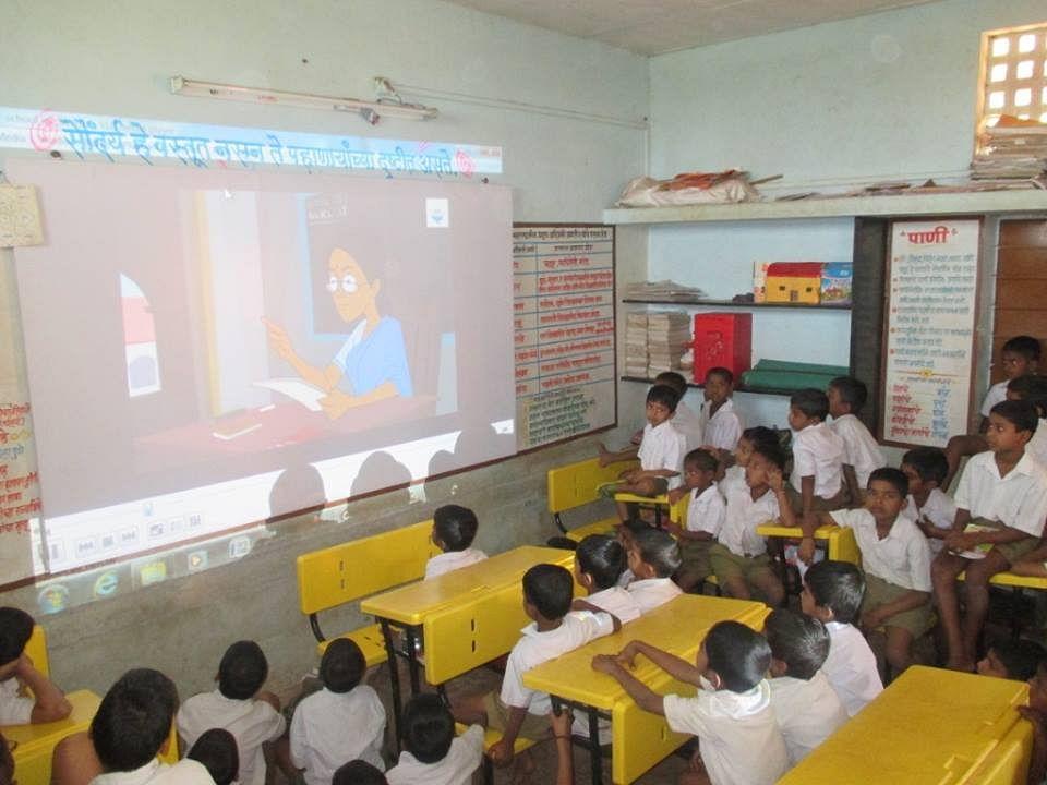 Students keenly watching awareness video - SBM Kolhapur Zilla (Maharastra)