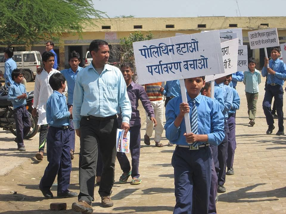 "Students holding placards ""Shun Polythene, Save Environment"" in Mewat district"
