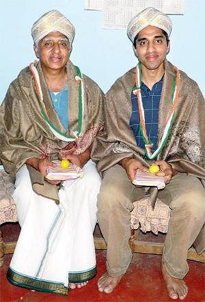 Vivek with his father Dr H.N. Lakshminarasimha Murthy, at Hallegere Village, Mandya, Karnataka