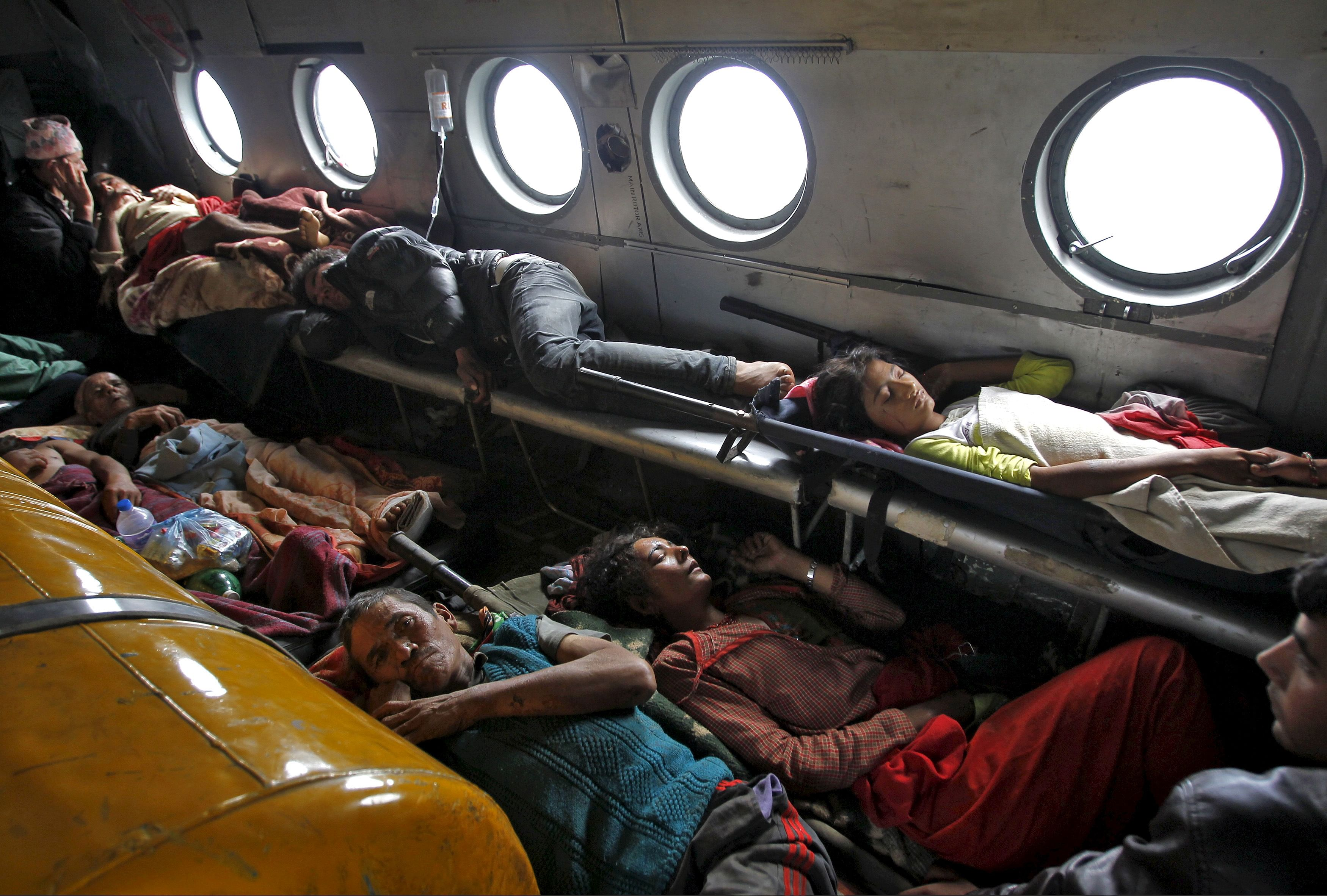 Victims of Saturday's earthquake lie inside an Indian Air Force helicopter as they are evacuated from Trishuli Bazar to the airport in Kathmandu, Nepal, April 27, 2015. REUTERS/Jitendra Prakash   - RTX1AH8L