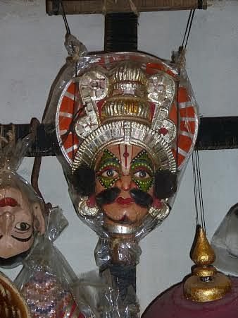 The  colourful puppet mask.