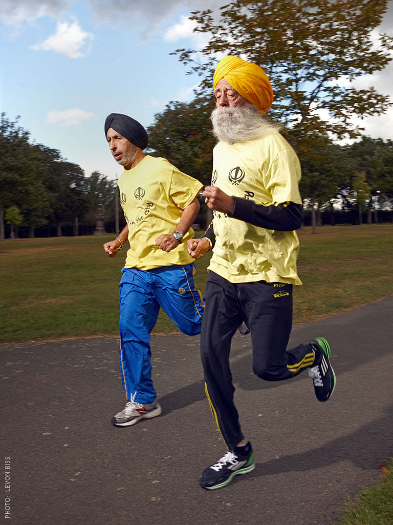 Coach Harmander Singh runs with Fauja in Valentines Park in Redbridge, London.
