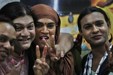 NEW DELHI, INDIA - APRIL 15: Transgender express their happiness victory signs after the Supreme Court verdict in which it granted recognition to transgenders as third category of sex on April 15, 2014 in New Delhi, India. SC also directed Centre and states to provide facilities of healthcare and education to transgenders, saying they are socially backward community. (Photo by Raj K Raj/Hindustan Times via Getty Images)