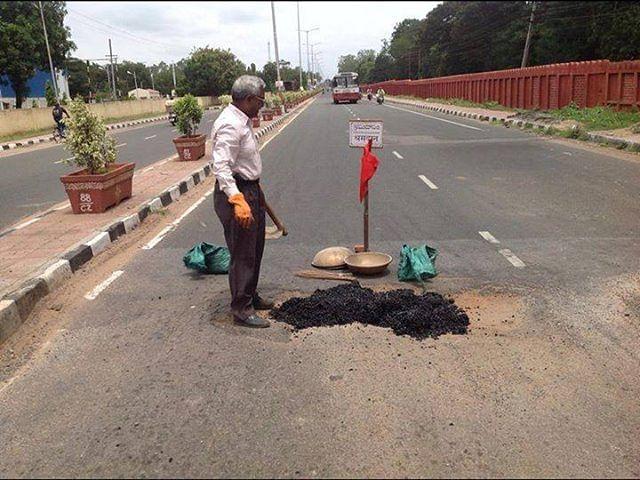 Gangadhar has filled over 1,124 potholes so far.