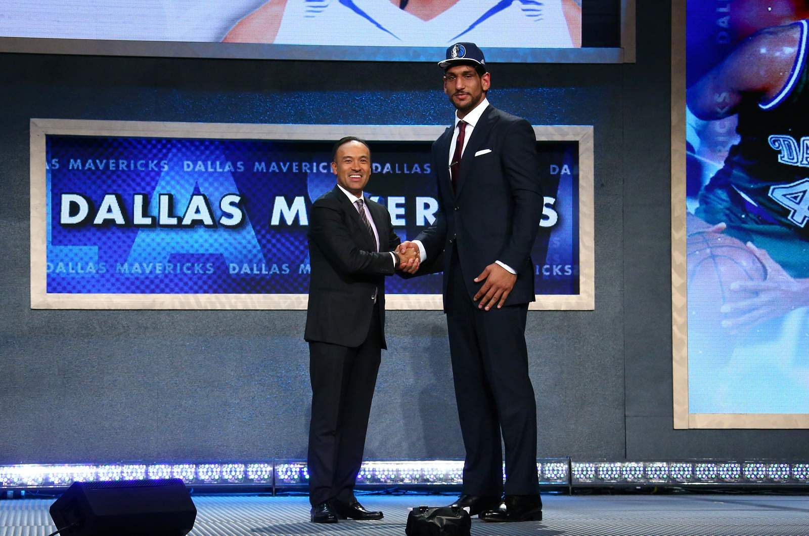 BROOKLYN, NY - JUNE 25: Satnam Singh shakes hands with Deputy Commissioner and Chief Operating Officer of the National Basketball Association, Mark Tatum after being selected number fifty two overall by the Dallas Mavericks during the 2015 NBA Draft on June 25, 2015 at Barclays Center in Brooklyn, New York. NOTE TO USER: User expressly acknowledges and agrees that, by downloading and or using this photograph, User is consenting to the terms and conditions of the Getty Images License Agreement. Mandatory Copyright Notice: Copyright 2015 NBAE (Photo by Nathaniel S. Butler /NBAE via Getty Images)