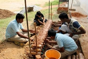 Children of TVS Academy, Hosur using discarded plastic bottles to make a creative play cum discussion area.
