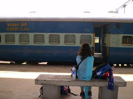 Zekiye Yildirim waiting for train in Alleppey, India.