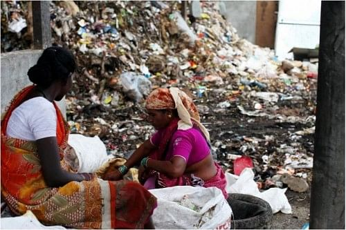 As they sift through garbage, waste pickers, who are mostly women, have to fend off stray animals, their hands get wounded by shards of broken glass thrown carelessly in the rubbish, and harassment by the police is part of their daily routine. (Credit: Amit Thavaraj)