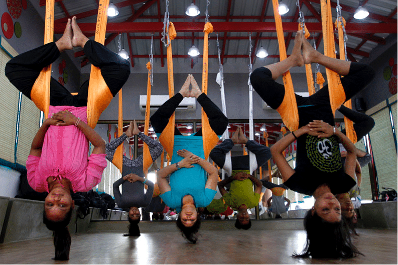 AERIAL YOGA OR ANTI-GRAVITY YOGA BEING PERFORMED BY STUDENTS IN AHMEDABAD AP PHOTO/AJIT SOLANKI
