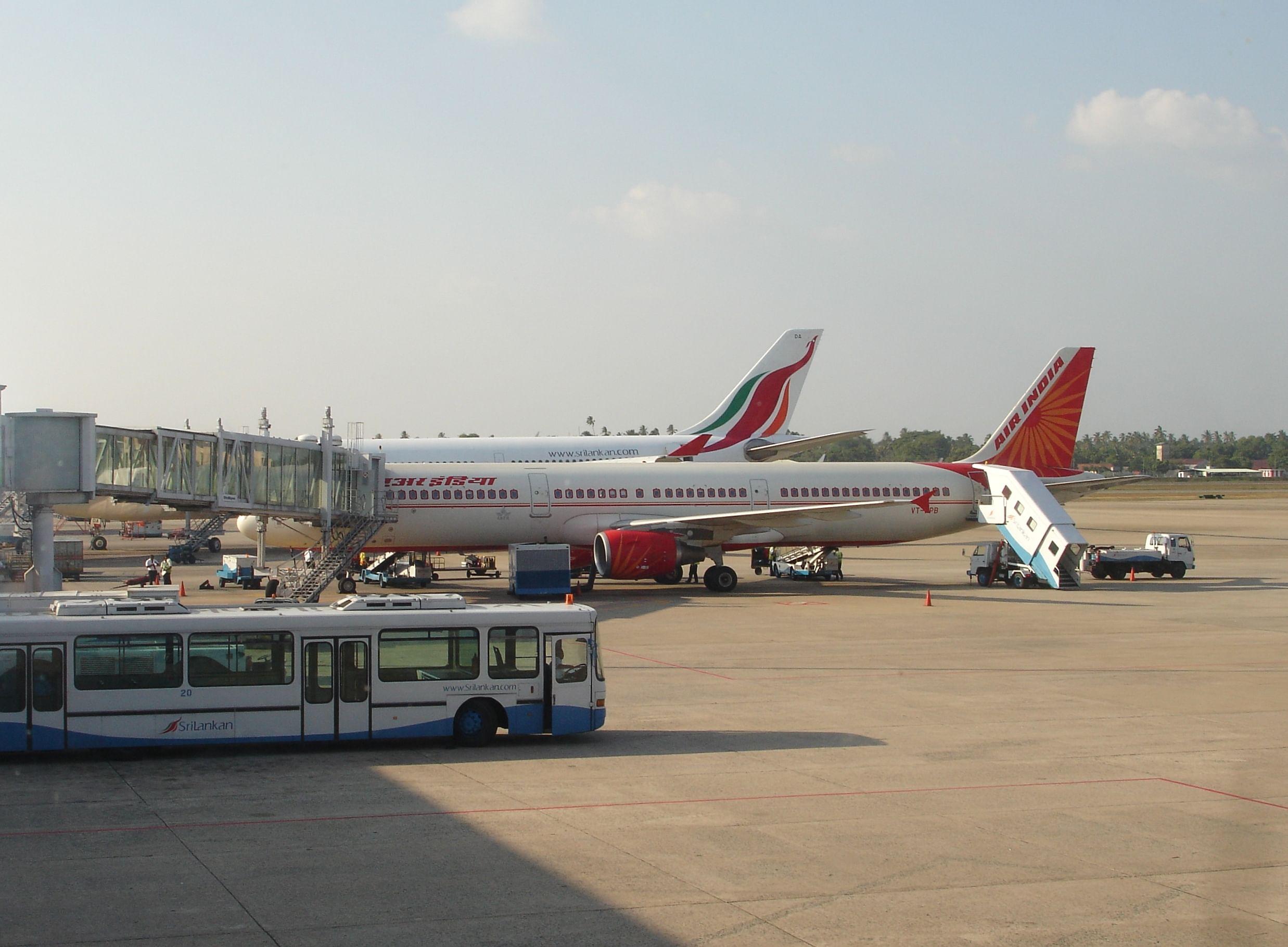 Air_India_and_SriLankan_aircraft_at_colomobo_airport_terminal