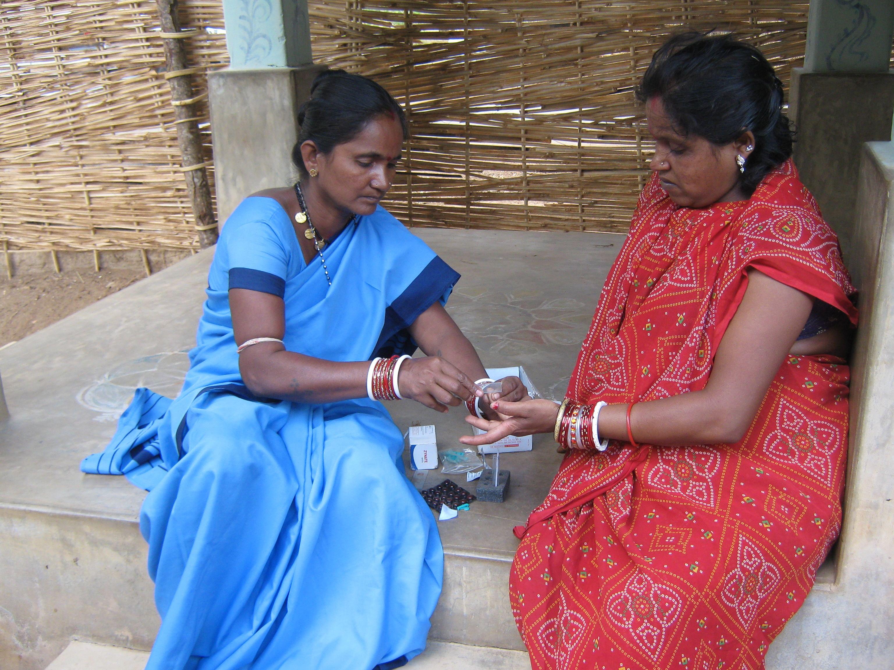 ASHA Parvati Dora collecting blood. (Credit: Sarada Lehangir\WFS)