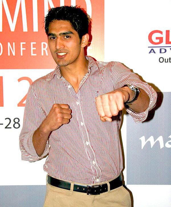 """Vijendersingh2"" by IndiaFM - Vijender Singh strikes a pose at Milind Soman's party. Licensed under CC BY 3.0 via Wikimedia Commons"