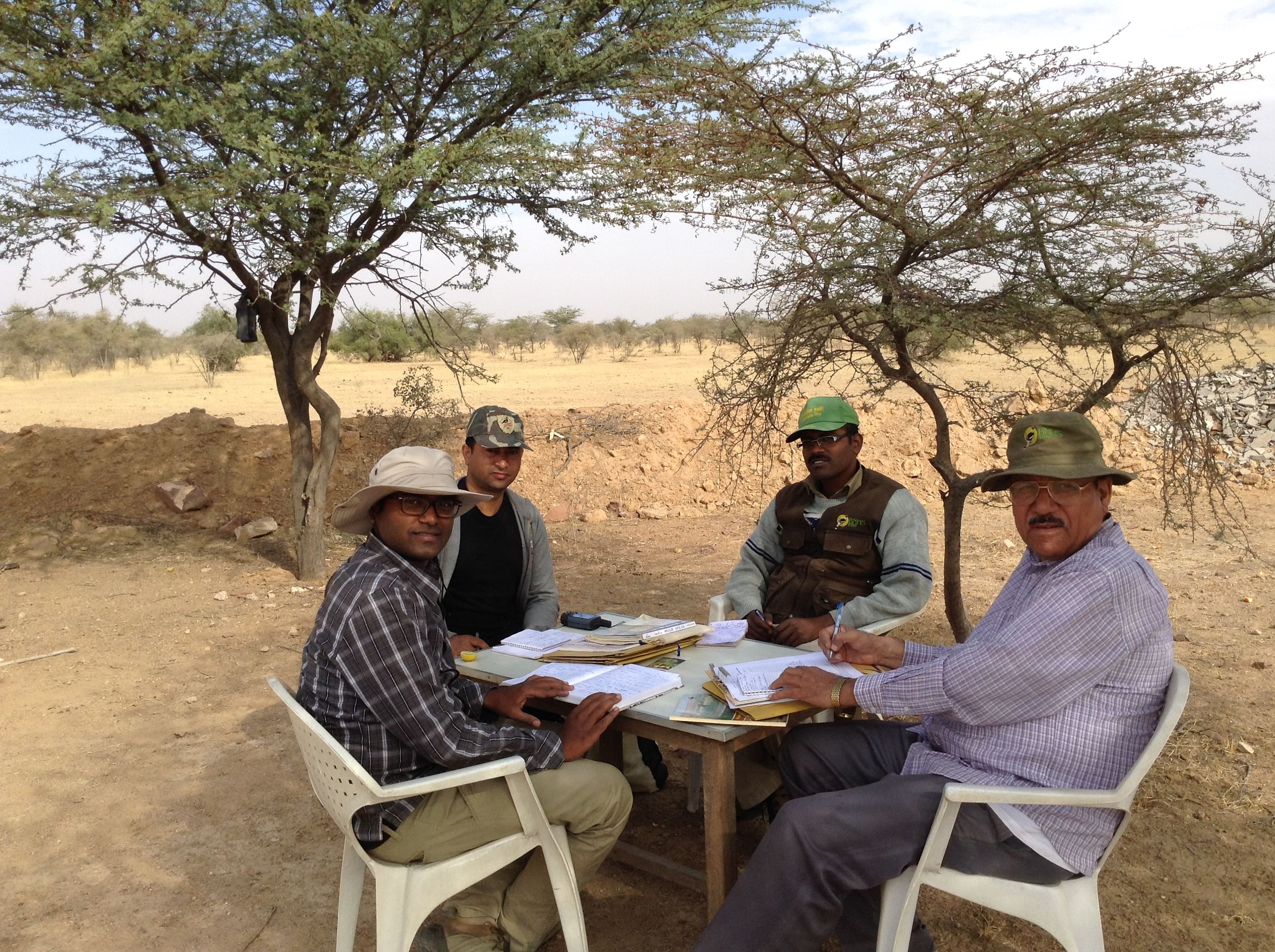 Dr. Patil (first from left) in the field with his colleagues