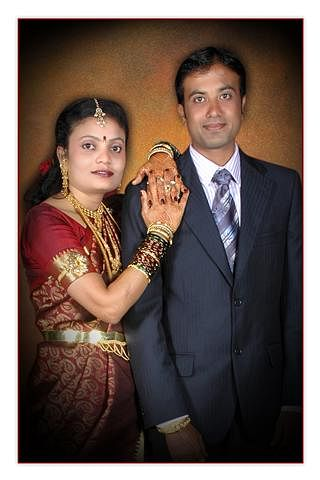 Raghu with his wife.