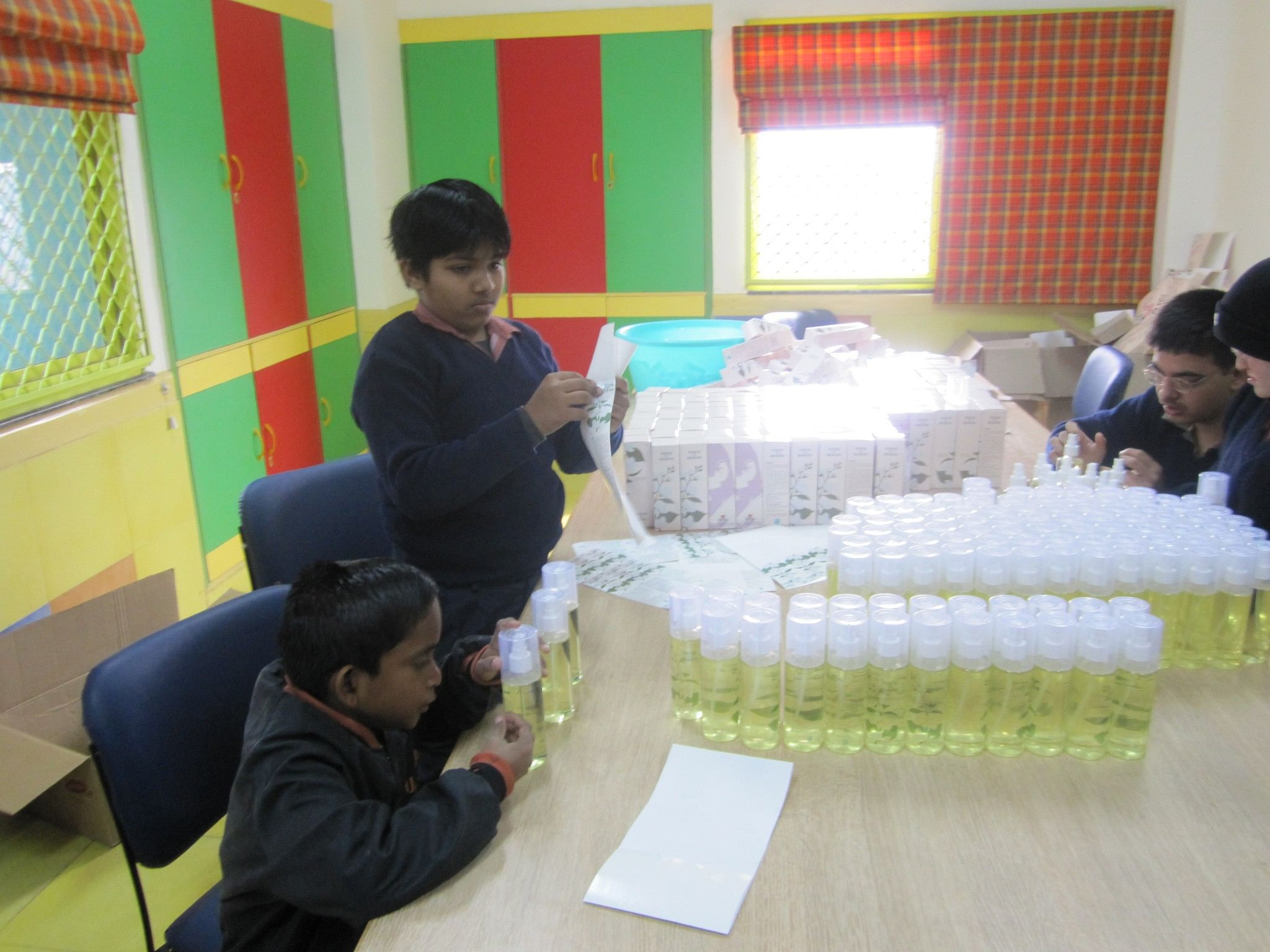 At the Savera School, children battling with physical and mental disorders such as Down's Syndrome and Autism are taught employable skills – like packing air fresheners that are eventually sold. (Credit: Naunidhi Kaur\WFS)