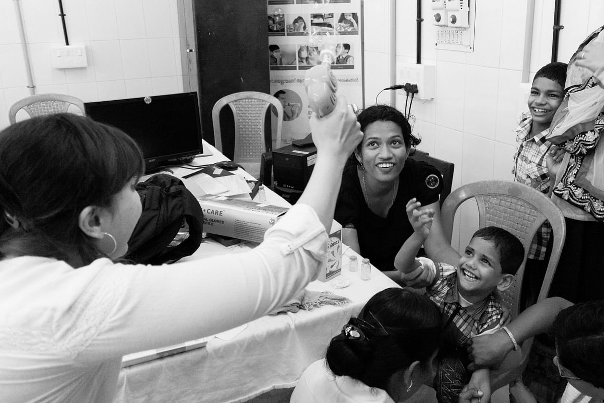 Smriti Rana, Consulting Psychologist and Programme Director of the Children's Palliative Care Project, plays catalyst between the children and their mirth, at the Thursday clinics.