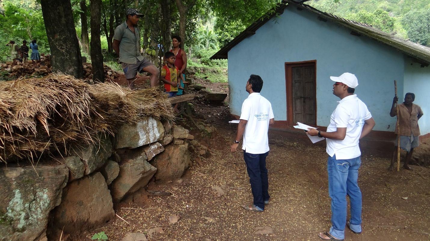 Prakash Kumar Sahoo with Junior engineer of Nuagada block inspecting toilet construction work during a field visit to Kudinda village