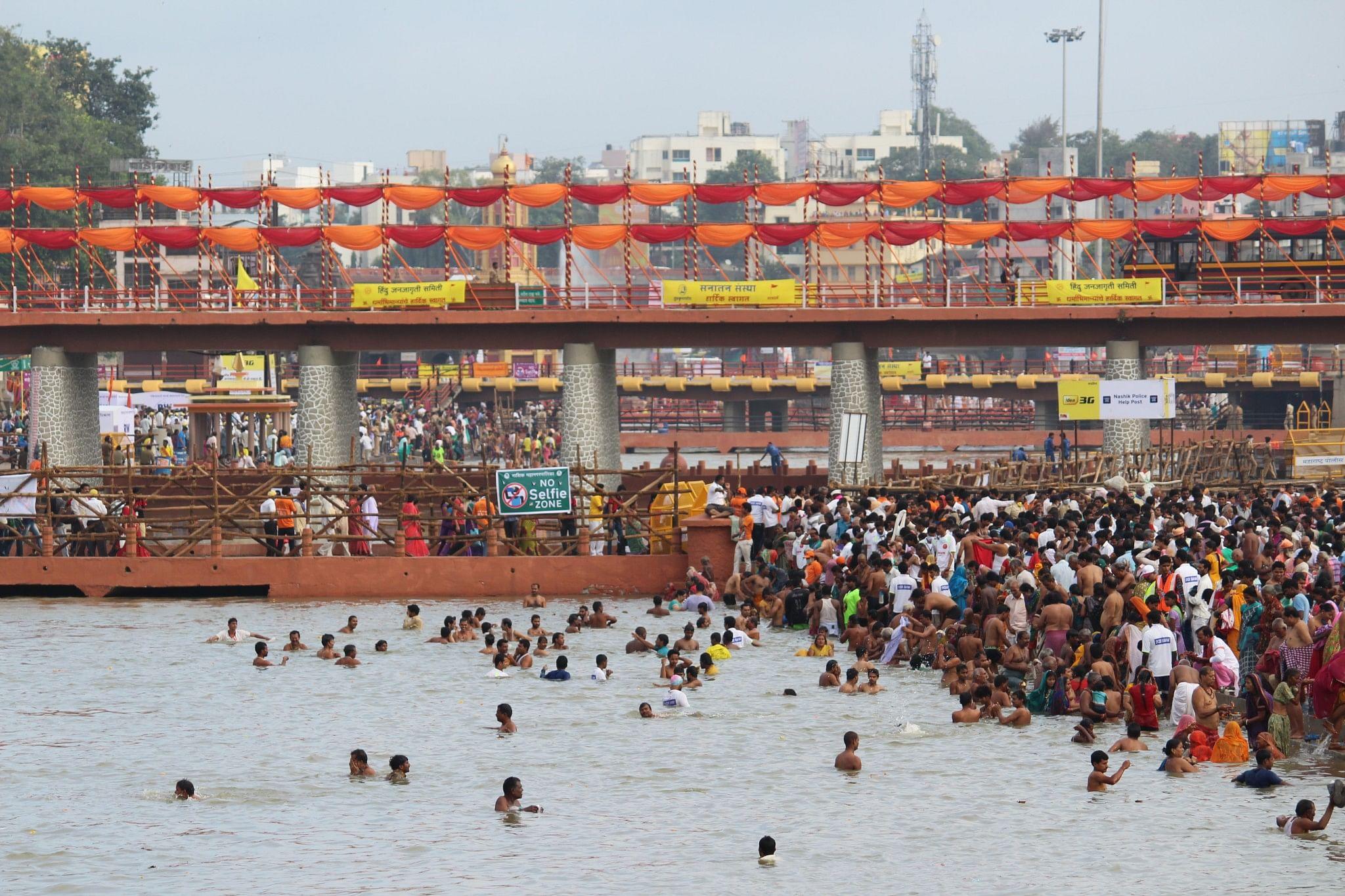 Pilgrims take a dip on occasion of Shahi Snan at Nashik
