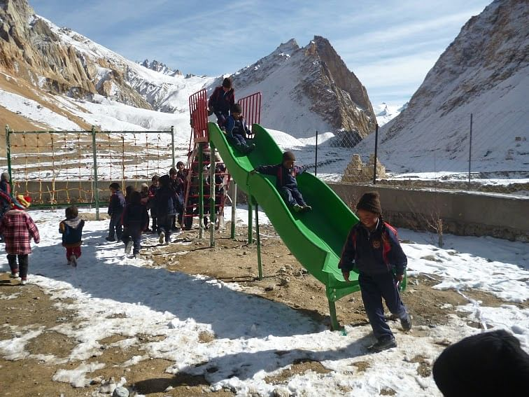Middle School Kanji, last village before the Kargil border gets a playground which the team installed in the November. The snow does not stop the children from playing. altitude - 10211, No. of Children - 46