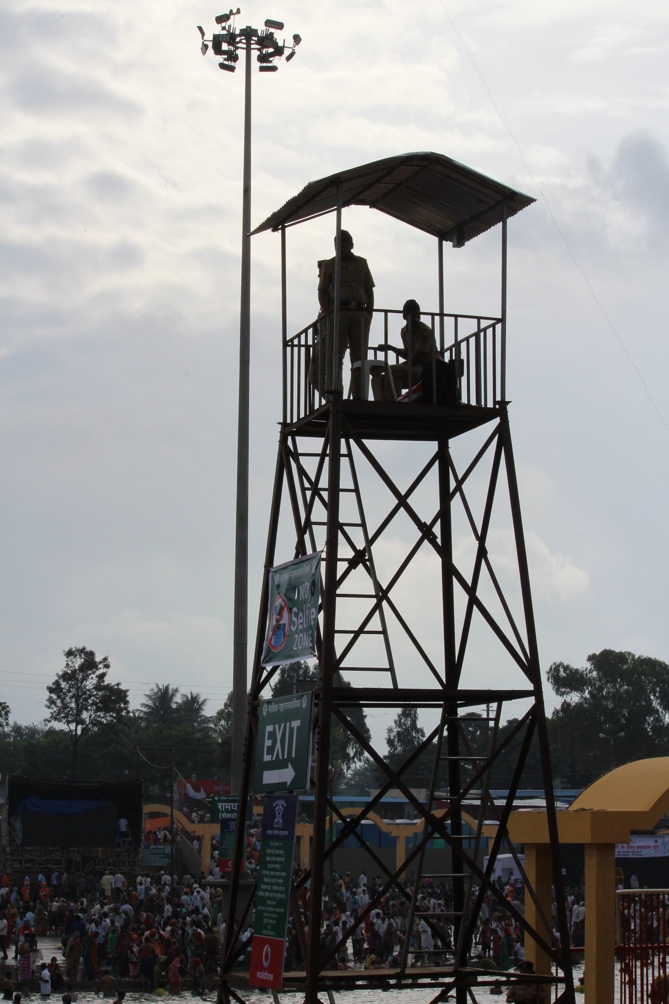 Policemen located on the watch tower for crowd management