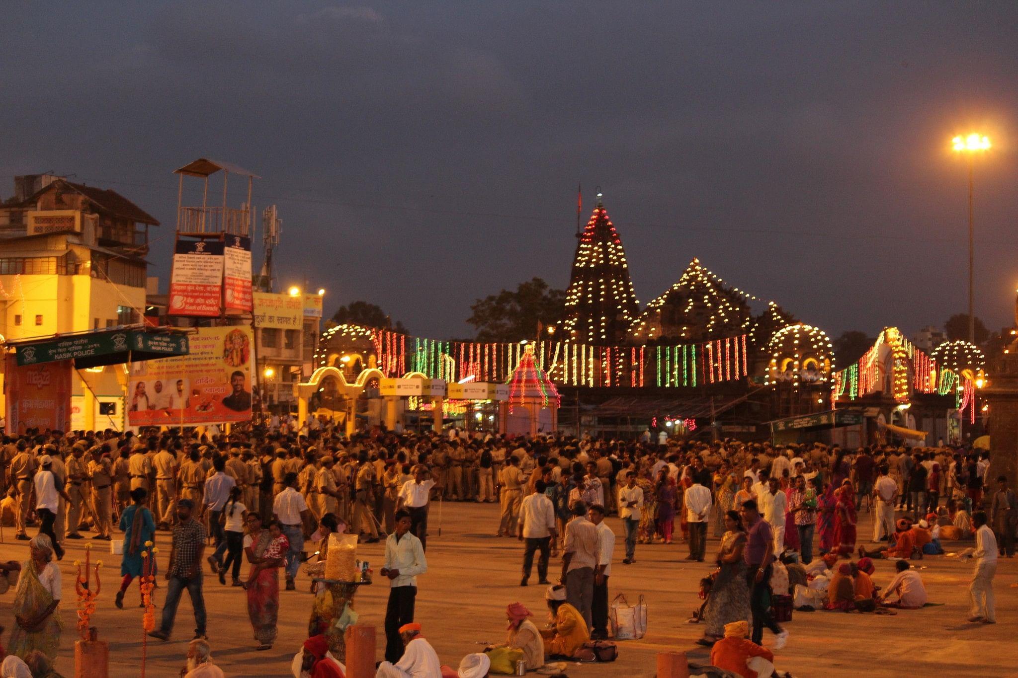 Decorations at night illuminate all temples and bridges, Ramkund, Nashik