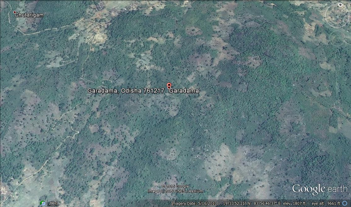 A Google Earth image of this panchayat, surrounded by forests and large mountains.