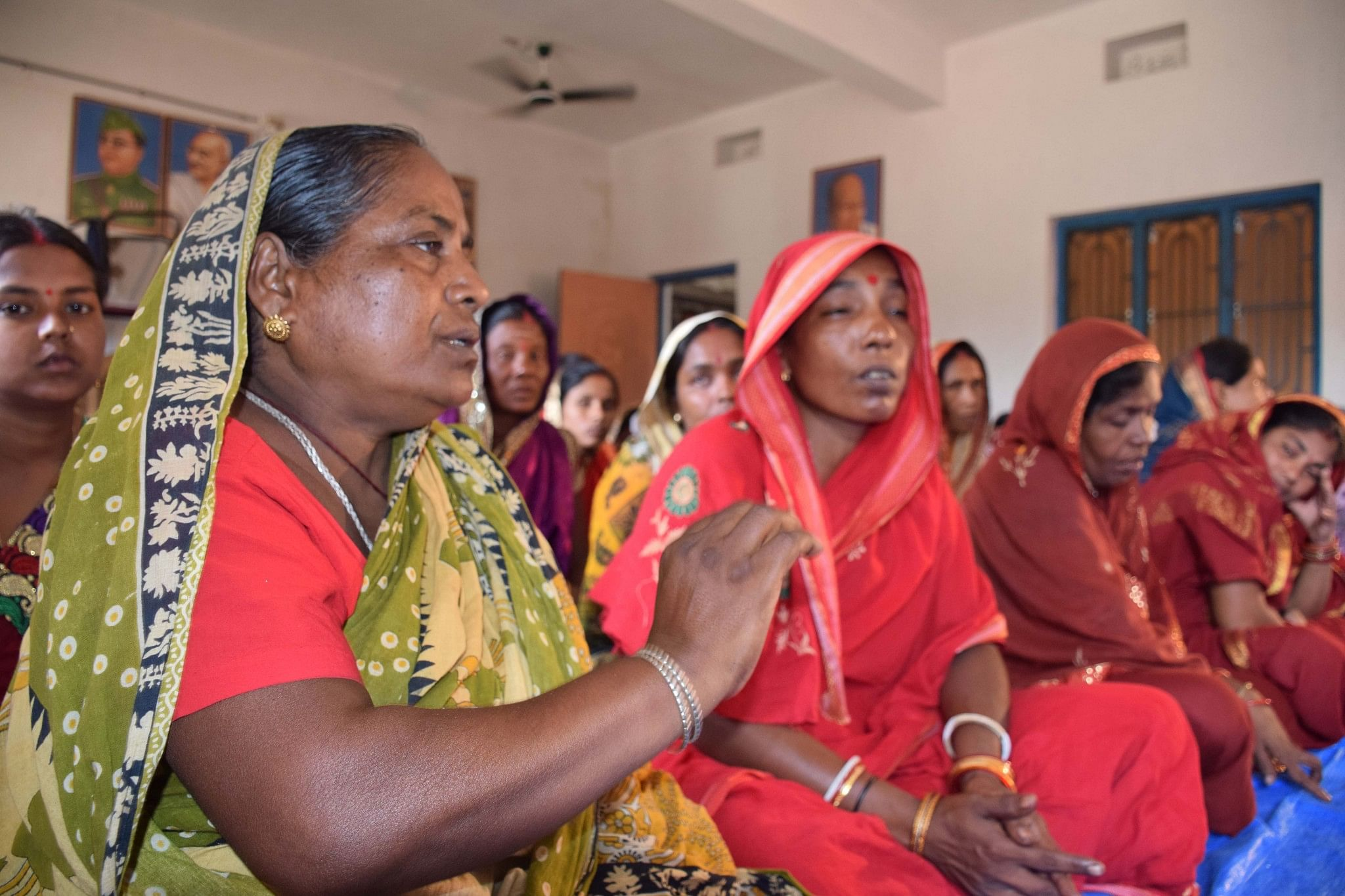 Sabita Pradhan (in green sari), president of the women's self-help group of Hatiapal village, believes that more active women panchayat members will expedite the change towards reducing the social acceptance of violence against a woman. (Credit: Manipadma Jena\WFS)
