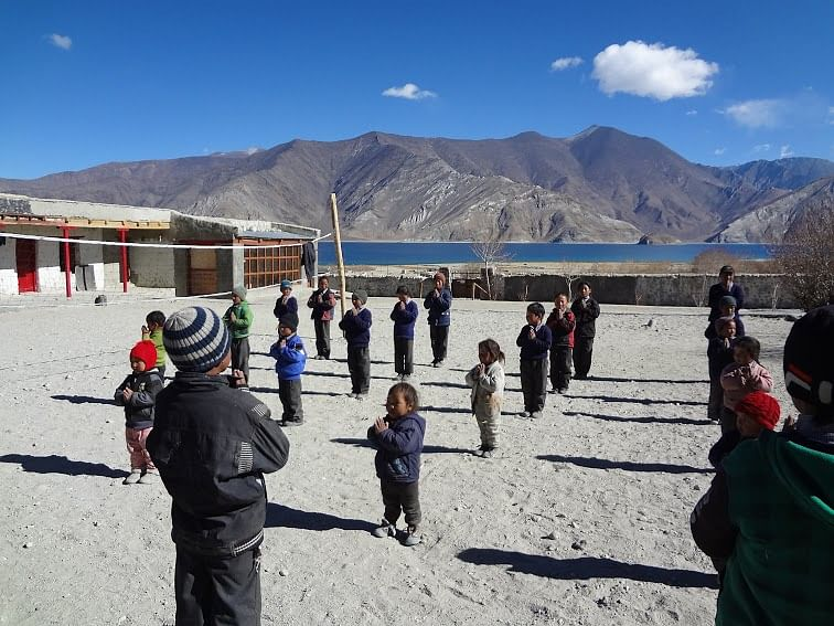 Middle School Merak, right beside the Pangong Tso lake with 35 children singing their morning prayers, altitude - 14098 ft.