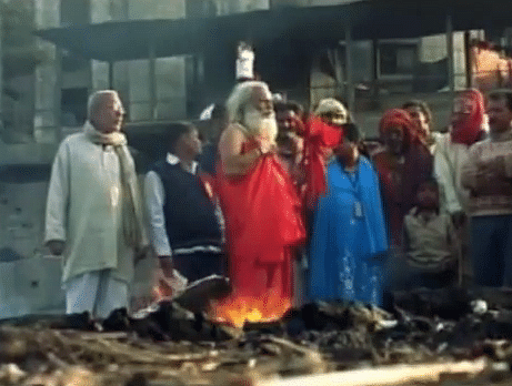 Vikas performs last rites of the unclaimed dead bodies found in the river.