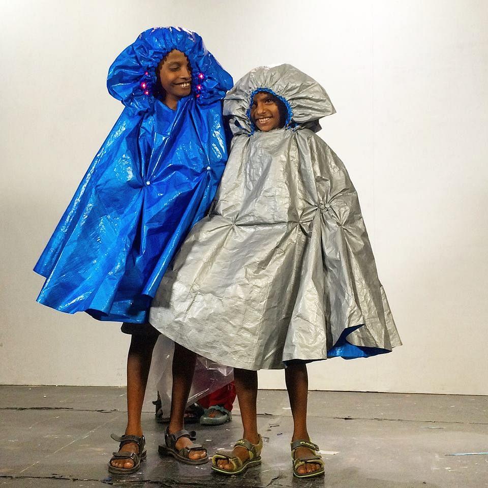 The happy raincoat owners