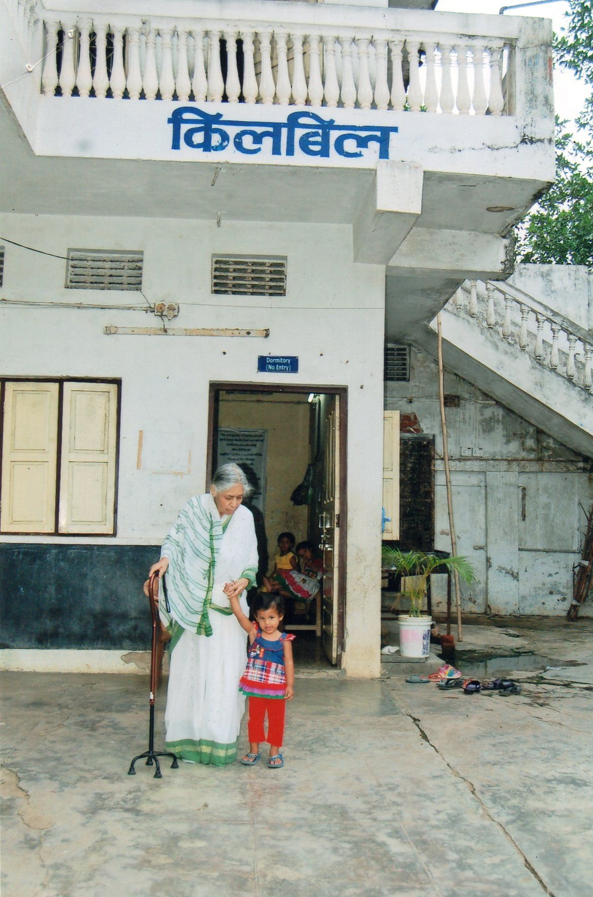 Prabhavati Muthal with a 1.5-year-old child who is waiting to be made free for adoption by CWC