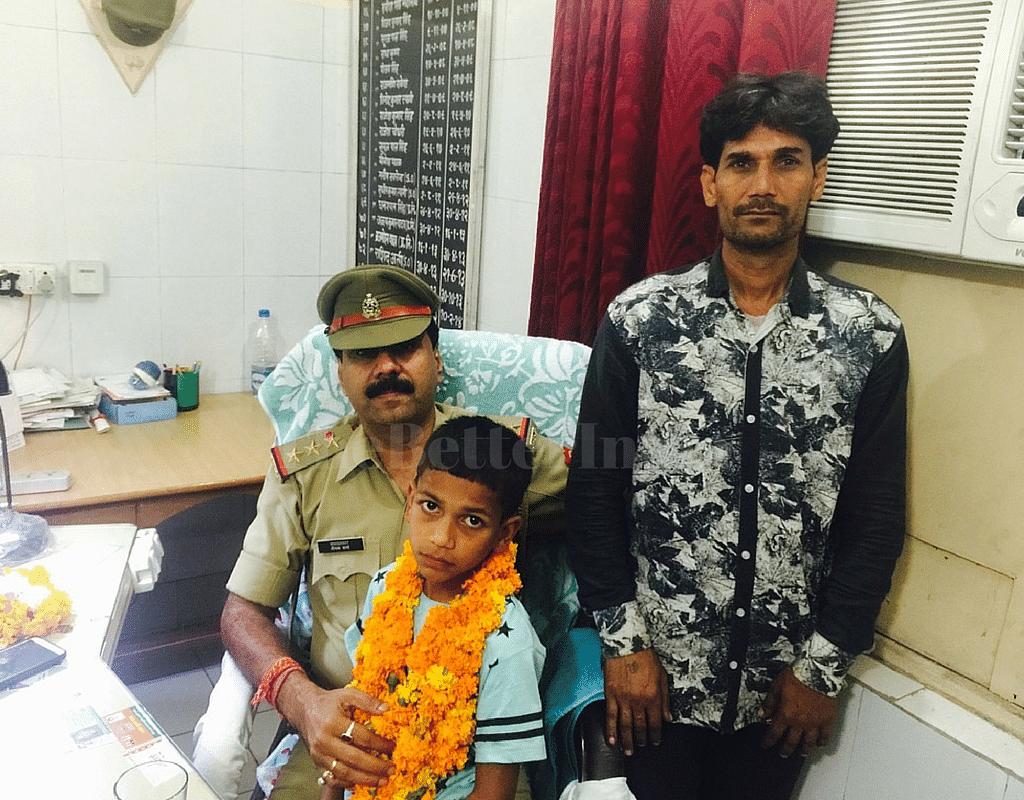 SHO of Modinagar, Mr. Deepak Sharma, with Vansh and his father, Mr. Gujjar.