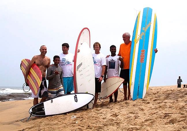 Murthy with Jonty Rhodes (centre) and the 'Surfing Swami' Jack Hebner (extreme right)